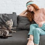 Cat and owner sitting on couch